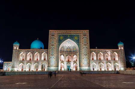 View of the Registan square in Samarkand and Tillya-Kari  madrassah (15th century) at night. Uzbekistan