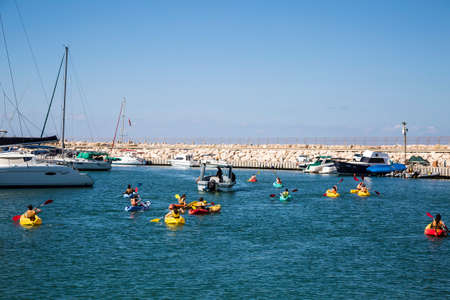 Children are trained to swim in kayaks, Ashdod, Israel
