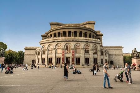 People walk near the Alexander Spendiarov Opera and Ballet Theater in Yerevan. Republic of Armenia