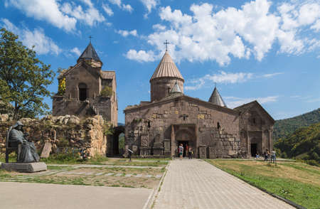 Tourists near Armenian medieval monastery complex XII-XIII centuries Goshavank in the village of Gosh in Armenia.