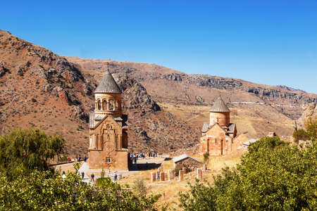 The medieval monastery of Noravank against the backdrop of mountains and blue sky in Armenia. Was founded in 1205. Top view.