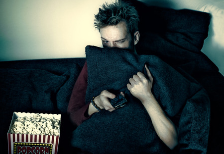 american downloads: Watching a scary movie Stock Photo