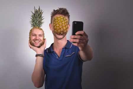 humoristic: Funny face swap with mobile phone Stock Photo