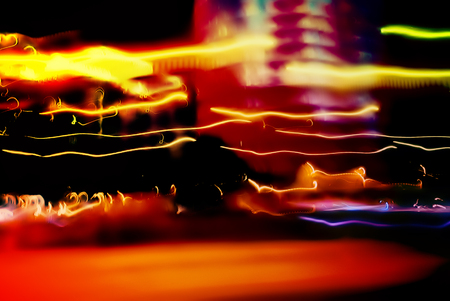 shiny car: Flows of light from the headlights of cars rushing along and light, illumination of buildings, blurred and frozen at the moment of movement. .Abstract backgrounds from the light streams
