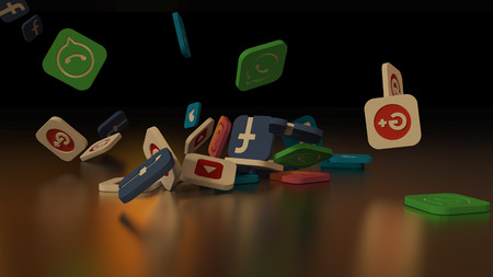 3d rendering of falling social networking icons. On a black background