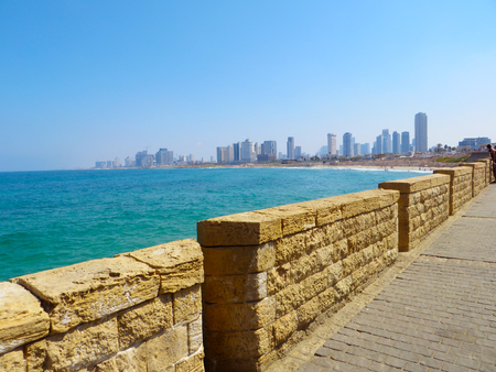Panoramic view of the coast of the city of Tel Aviv from the side of the embankment of the city of Jaffa. There are new skyscrapers of the city against the background of the old city. Summer of 2018