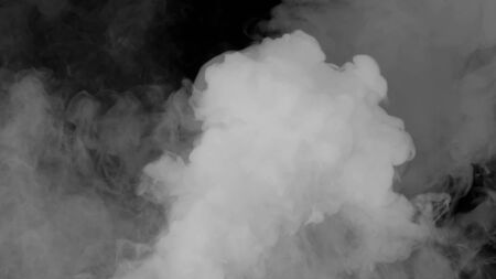 Abstract fog or smoke move on black color background. Smoke on a black background, the light in the smoke
