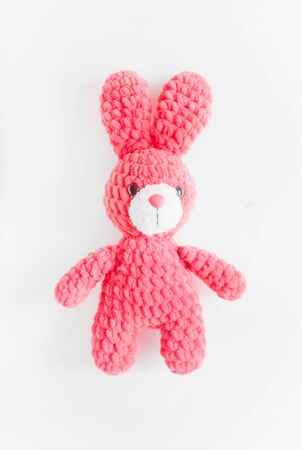 Plush pink rabbit on white background. Concept toys for children.games.girl.hobby. Easter Bunny. Easter Hare. Isolated
