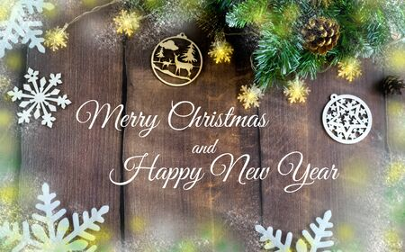 Merry Christmas and happy New year. Christmas decoration design on wooden background with candy bowl.the composition of Christmas tree branches, lights, cones, toys, candy, snowflakes. Foto de archivo - 130805327