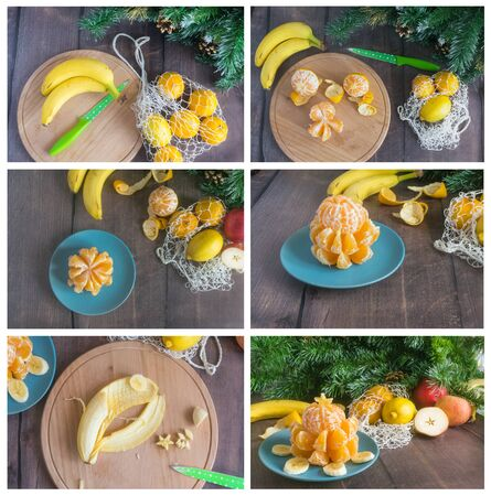 How to make an edible Christmas tree with children. Tutorial, step by step. Cooking with children Christmas tree of tangerines and banana on a blue plate on a wooden background. Christmas instruction. Foto de archivo - 133816763