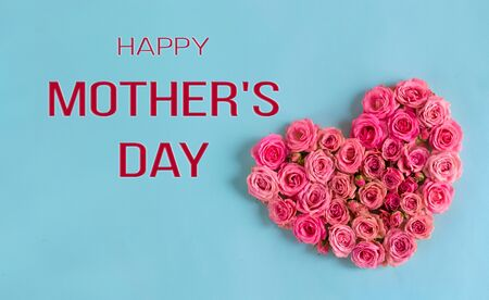 Mother's day banner.Holiday card with a heart of pink roses on a blue background.Congratulation.Creative.day.Women's day.Mother's day.love.postcard. Foto de archivo - 137585297