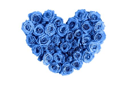 Valentine's day heart made of delicate roses in a classic blue color on a white background.Holiday card, banner for sale in the store.Spring wreath of flowers-a gift to your loved ones.March 8 Foto de archivo - 137994034