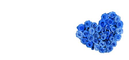 Valentine's day heart made of delicate roses in a classic blue color on a white background.Holiday card, banner for sale in the store.Spring wreath of flowers-a gift to your loved ones.March 8 Foto de archivo - 137995894