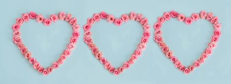 Valentine's day heart of delicate pink roses on a blue background.Holiday card, greeting I love you, calendar, banner for the store sales.Spring wreath of flowers a gift to your loved ones. March 8 Foto de archivo - 138424444