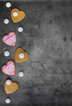 Mothers Day, Valentines Day, Womens day.Banner of gingerbread hearts on a dark stone background with space for text.Poster for sale in the store.Postcard favorite..Spring festival.vertical Фото со стока