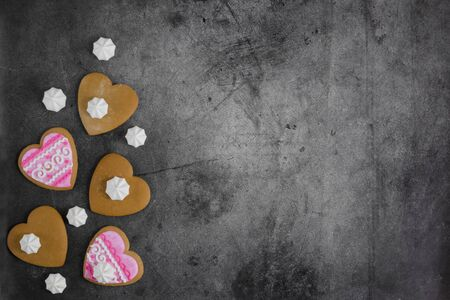 Mothers Day, Valentines Day, Womens day.Banner of gingerbread hearts on a dark stone background with space for text.Poster for sale in the store.Postcard favorite..Spring festival.copy space.