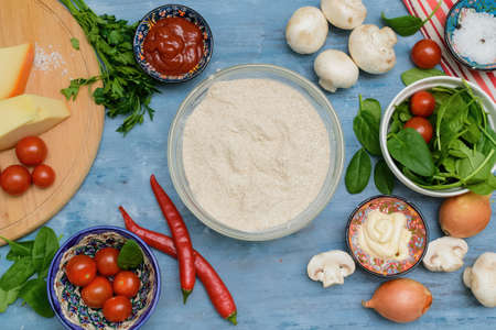Homemade Delicious pizza heart for Valentine's Day made of yeast-free dough with vegetables, tomatoes, herbs and cheese, prepared at home for festive dinner. Step by step recipe. Instructions. DIY. Step 2