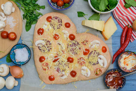 Homemade Delicious pizza heart for Valentine's Day made of yeast-free dough with vegetables, tomatoes, herbs and cheese, prepared at home for festive dinner. Step by step recipe. Instructions. DIY. Step 12