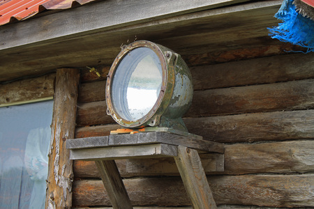 searchlight: Old lantern searchlight mounted on a wooden house