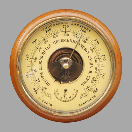 atmospheric pressure: Old russian barometer isolated on gray background Stock Photo
