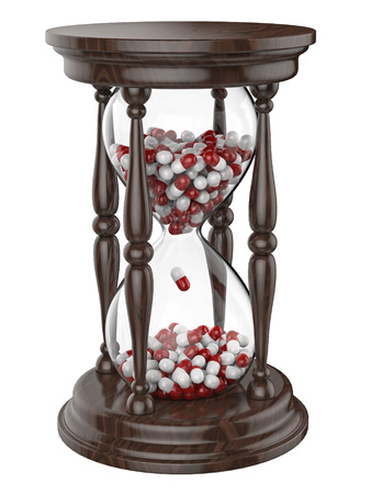 Time life hourglass with pills isolated on white background Banco de Imagens