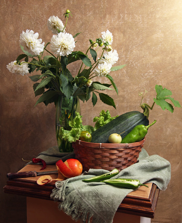Rustic farmhouse still life with fresh vegetables on background wall