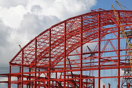 Building metal construction against the blue sky