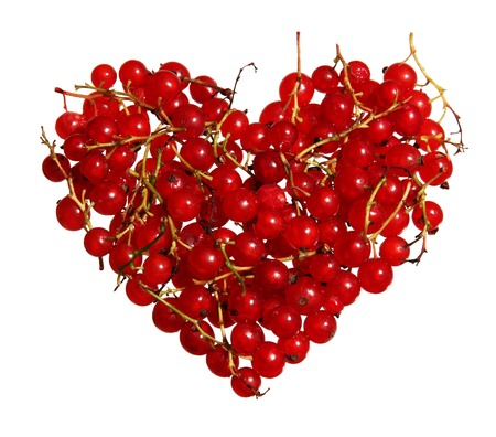 The heart of red currant berries isolated on white background