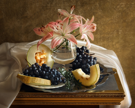 Still life with white lily, grapes and melon stylized antique Banco de Imagens