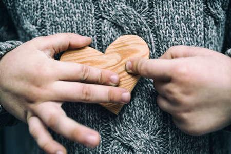 little people: little boy shared a small wood heart