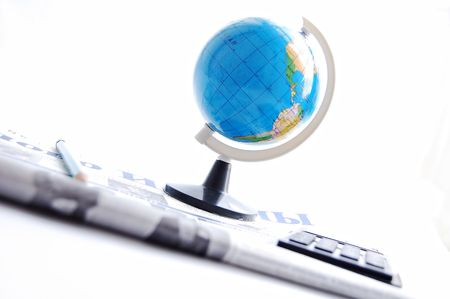 The globe, the newspaper, pencil and the calculator on a white background business Stock Photo - 5227255