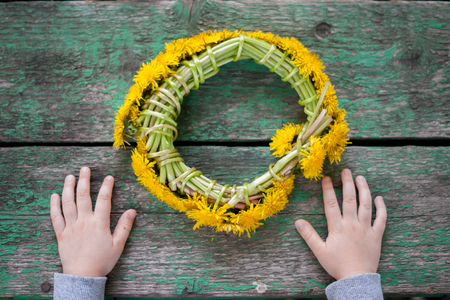 hasidism: child with a wreath from dandelions