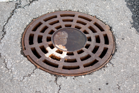 Rusty manhole on a parking