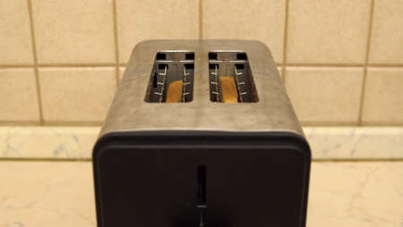 Toaster for making fried bread for breakfast. Electrical appliance in the kitchen Stock Photo