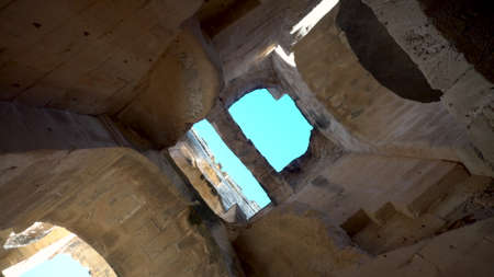 View inside the ruins of the amphitheater. The camera is spinning from the bottom up. Ancient Roman ruins. Ancient Amphitheater located in El Jem, Tunis. Historic Landmark. 写真素材