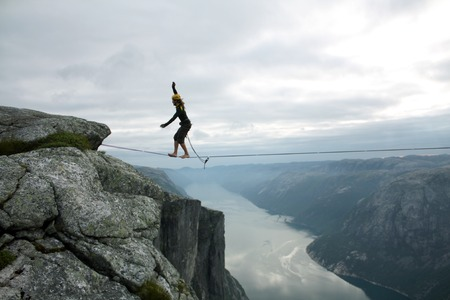 Slacklining is a practice in balance that typically uses nylon or polyester webbing tensioned between two anchor points. photo
