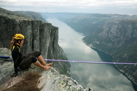 Slacklining is a practice in balance that typically uses nylon or polyester webbing tensioned between two anchor points.