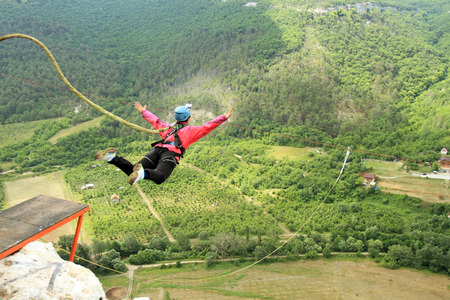 extreme sport: Jump off a cliff with a rope.