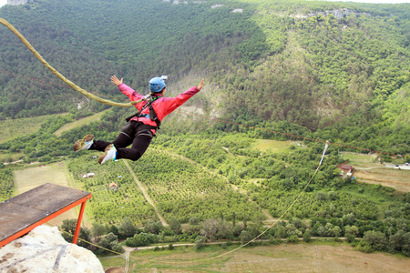 jump: Jump off a cliff with a rope.