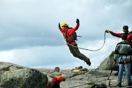 Jump off a cliff with a rope, mountain, sea, nature, Stock Photo