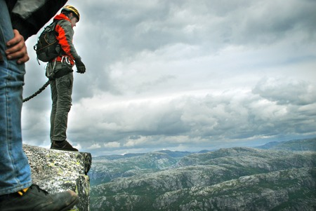 diving: Jump off a cliff with a rope, mountain, sea, nature, Stock Photo