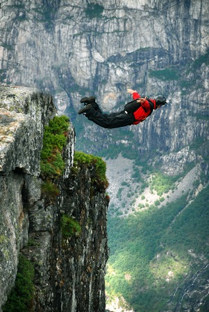 Jump off a cliff with a rope, mountain, sea, nature, Stock Photo - 37187729