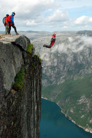 sky diving: Jump off a cliff with a rope, mountain, sea, nature, Stock Photo
