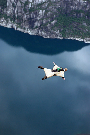 Jump off a cliff with a rope, mountain, sea, nature, Standard-Bild