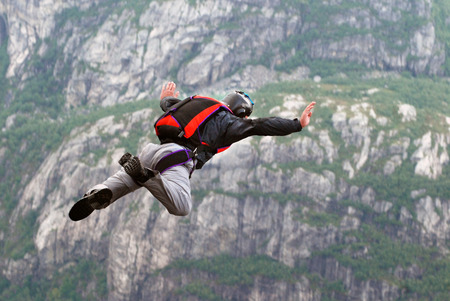cliff jumping: Jump off a cliff with a rope, mountain, sea, nature, Stock Photo