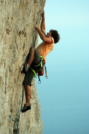 rockclimber: The rock-climber during rock conquest.Climber.Young climbing in the Dolomits.