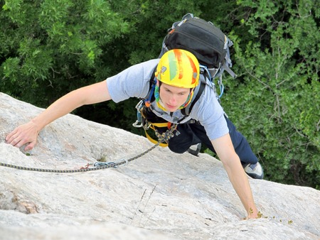 rockclimber: The rockclimber during rock conquest.Climber.Young climbing in the Dolomits. Stock Photo