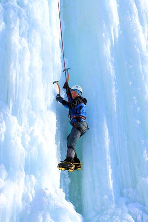 ice climbing: Ice climbing the waterfall. Stock Photo