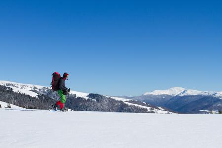 snowshoeing: snowshoeing winter hiking. Stock Photo