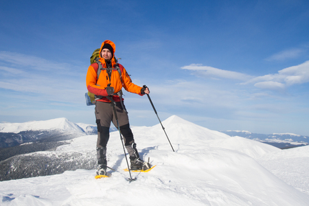 snowshoeing: snowshoeing winter hiking. Stock Photo